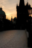 Prague Dawn. Charles bridge, cobbles and silhouetted against dawn sky Royalty Free Stock Photos