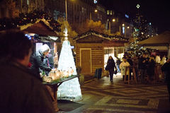 PRAGUE - DECEMBER 07: Christmas tree decorating a street market Royalty Free Stock Photo