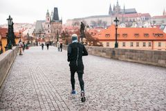 Prague, December 24, 2016: A man athlete has a morning run in the winter on the Charles Bridge in Prague in the Czech Stock Photos