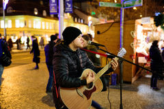 PRAGUE - DECEMBER 07: street performer playing the guitar at a C royalty free stock images