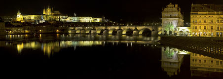 Prague at dusk, view of the Lesser Bridge Tower of Charles Bridg Royalty Free Stock Photography