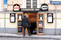 Prague. Entrance to the steakhouse bar Stock Photos