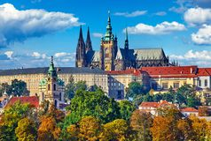 Prague fall landscape view to Saint Vitus Cathedral with blue sky and white clouds. Royalty Free Stock Image