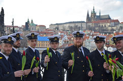 PRAGUE - FEB 23: A group of sailors on the River Vltava riverbank Royalty Free Stock Image