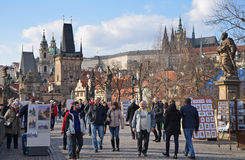 PRAGUE - FEB 23: Tourism on the Charles Bridge Royalty Free Stock Images