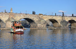 PRAGUE - FEB 23: Tourist boat sailing near the Charles Bridge Royalty Free Stock Photography