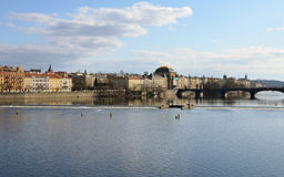 PRAGUE - FEB 23: View of Prague waterfront across the Vltava river Stock Images