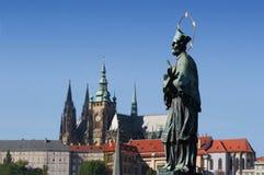 Prague gothic Castle. St. John of Nepomukand Prague gothic Castle, Charles bridge,  Czech republic Royalty Free Stock Image