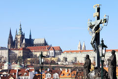 Prague gothic Castle from Charles Bridge with its Statues Stock Photography