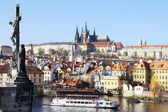 Prague gothic Castle from Charles Bridge with its Statues Stock Image