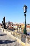 Prague gothic Castle from Charles Bridge with its Statues Stock Photo