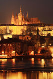 Prague gothic Castle with Charles Bridge in the Night Stock Image
