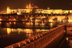 Prague gothic Castle with Charles Bridge in the Night Royalty Free Stock Image