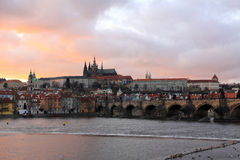 Prague gothic Castle with Charles Bridge after sunset, Czech Republic Stock Image