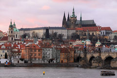 Prague gothic Castle with Charles Bridge after sunset, Czech Republic Royalty Free Stock Images