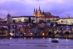Prague gothic Castle with Charles Bridge after sunset, Czech Republic Stock Photography