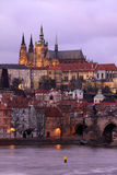 Prague gothic Castle with Charles Bridge after sunset, Czech Republic Royalty Free Stock Photo