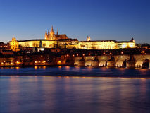 Prague gothic Castle past Sunset on Vltav Royalty Free Stock Photo