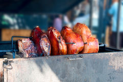 Prague ham. Preparation of the Prague ham on a spit stock photography