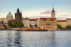 Prague, historical buildings next to Charles Bridge across the r Stock Photography