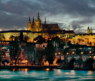 Prague & Hradcany, Prague, by night. Prague & Hradcany, Prague, with Charles Bridge in the foreground Stock Photos