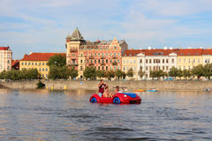 PRAGUE JULY 22: Pedal boat car with young man on the river Vltava in centre of Prague Royalty Free Stock Photos