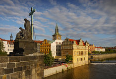 Prague Landmarks Heritage UNESCO. Statue of the Lamentation of Christ and the old town seen from the Charles Bridge in Prague, Czech Republic royalty free stock images