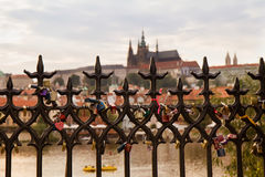Prague. Love locks with St. Vitus in background. Royalty Free Stock Images