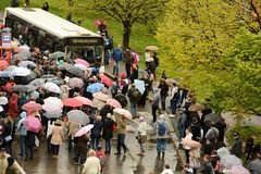 People waiting in the rain for a bus. Prague. Metro line A is closed for technical reasons. Passengers must continue to ride the bus and waiting to begin stock photo