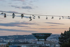 Prague metronome, Letna district hill, sunset sunsire with shoes haging on line Royalty Free Stock Images