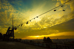 Prague Metronome, Shoes on a wire at romantic sunrise Royalty Free Stock Photo