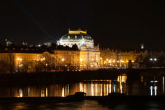 Prague National theatre by night, river Vltava right bank Stock Photos