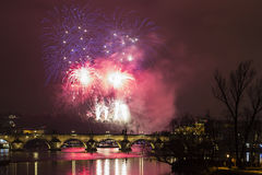 Prague New Year fireworks. Over Charles bridge and the river Vltava (Moldau stock photography