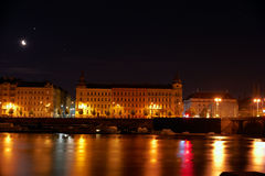 Prague at night. Night lights shine in the Vltava river in Prague Royalty Free Stock Images