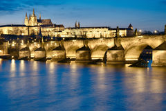 Prague at night, Charles Bridge from across the river Stock Photos