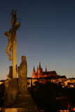 Prague at night with Jesus. Prague castle with a cross with Jesus on in the foreground. The cross is on Charles Bridge. Prague is a very popular tourist royalty free stock photos