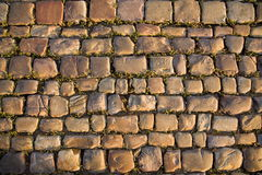 Prague old road. Stone structure of old Prague road. Background texture Royalty Free Stock Images