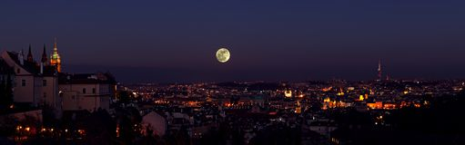 Prague old town night cityscape with full moon Royalty Free Stock Photography