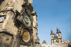 Prague astronomical clock and Old Town Square, Czech Republic. Prague Old Town Square with astronomical clock, view of the Virgin Mary Church dominating before Stock Photos