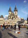 Prague, Old Town Square. Crowds of tourists and one living statue on Old Town Square with iconic Tyn Church. Prague Royalty Free Stock Photo