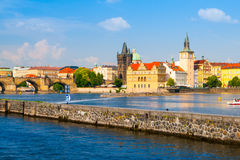 Prague Old Town towers with Charles Bridge over Vltava river Stock Photography