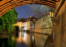 Prague, old watermill under. Devil influx Vltava. The picture was taken at night under the arches of the Charles Bridge on prolonged exposure Stock Photography