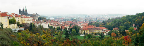Prague Panorama. A panoramic view of Prague in autumn with red orange and yellow trees, Czech Republic royalty free stock photos