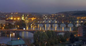Prague - The panorama of the city with the bridges at dusk stock image