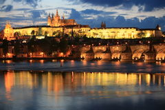 Prague panorama at night. Panoramic night view to Lesser Town, Prague castle, St. Nicholas church and Charles bridge Stock Images