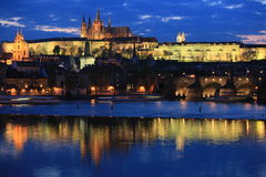 Prague panorama at night. Panoramic night view to Lesser Town, Prague castle, St. Nicholas church and Charles bridge Royalty Free Stock Images
