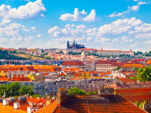 Prague panorama with Prague Castle - Hradcany and red rooftops. Sunny summer day with blue sky and white clouds, Czech Royalty Free Stock Image