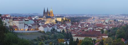 Prague - The panorama of the Town with the Castle and St. Vitus cathedral at dusk royalty free stock image
