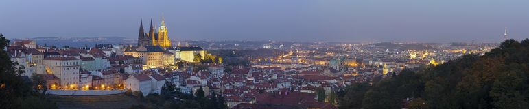 Prague - The panorama of the Town with the Castle and St. Vitus cathedral at dusk stock image