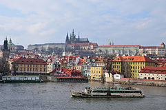 Prague and Prague Castle. View of Prague Castle from across the Vitava river with a tourist boat Stock Image